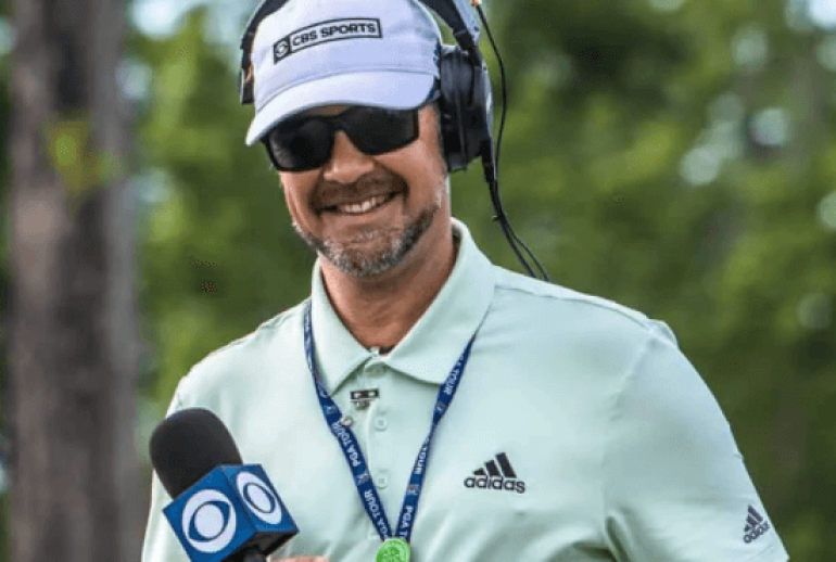 mark immelman with microphone broadcasting from golf course